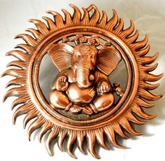 Ganesh 15 Inches Wall Door Hanging with Copper Finish for Prosperity and Good Luck Perfect Housewarming Gift Mother's Day Special The Modish Store,http://www.amazon.com/dp/B00I3PX0ZG/ref=cm_sw_r_pi_dp_Kqaztb0G11Y43A0Q