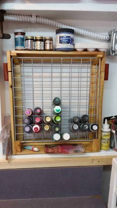 This is not an original idea. I saw similar ideas here, and since I had scrap wood leftover from other pallet projects, as well as some of those wire panels from the DIY wire crate/shelving kits you gethellip; Scrap Wood Projects, Diy Pallet Projects, Woodworking Projects, Pallet Ideas, Wood Storage Rack, Craft Storage, Paint Storage, Wood Rack, Crate Shelves
