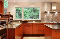 Stainless tile backsplash--love the reflection and it is NOT subway tile!