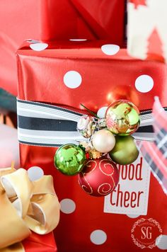 Embellish Gifts:ornaments & jingle bells strung together with a silver wire & attached to back of ribbon