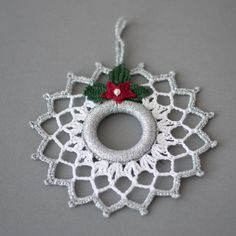 Lovely crochet Christmas wreath. Christmas decoration. Silver white decor. This wreath is 5.7 (14 cm.) in diameter. Hand crocheted with high-quality cotton thread in a smoke-free and pet-free environment whit great attention to details. It is starched and arrives very well packed in a sturdy box. You can find other Christmas ornaments and presents for your loved ones here: https://www.etsy.com/shop/SevisMagicalStitches?ref=l2-shopheader-name and some knitted ite...