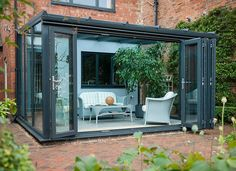 Modern conservatory with bifold doors. Got a dream conservatory in mind? Talk to Elglaze to make it real Lean To Conservatory, Conservatory Design, House Extension Plans, House Extension Design, Garden Room Extensions, House Extensions, Glass Green House, Door Design, House Design