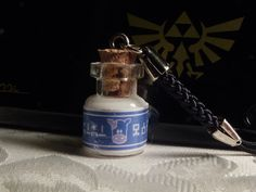 ADORABLE. Miniature Legend of Zelda Lon Lon Milk Bottle Cell Charm Keychain. $9.00, via Etsy.