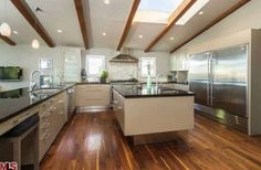 19 Celebrity Kitchens That Will Make You Jealous: JOHN KRASINSKI AND EMILY BLUNT Emily Blunt and John Krasinski's new Los Angeles home, which they bought a few months ago for $2.57 million, has a thoughtful open floor plan with a large kitchen.