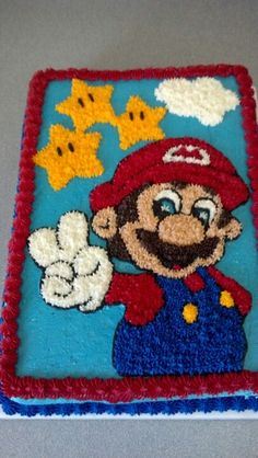 Mario cake.  Maybe I can do it?! For Mackenzie's birthday coming up lol