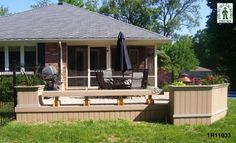 Low, medium size, single level deck design with planters and a bench.