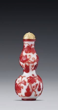 A RUBY-RED WHITE OVERLAY GLASS 'DOUBLE-GOURD' SNUFF BOTTLE QING DYNASTY, QIANLONG PERIOD