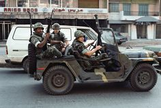 Marines drive an M151A2 jeep in Beirut, Lebanon, 1983