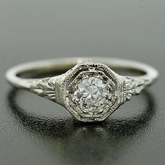 Simple, beautiful Art Deco engagement ring with a traditional octogonal shaped setting. So lovely!