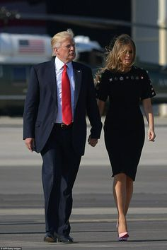 The first lady held her husband's hand as they made their way to Air Force One in Italy on. Melania Trump, dress with button details, walking, May 2017 Donald And Melania Trump, First Lady Melania Trump, Donald Trump, Trump Melania, Malania Trump, Trump One, Dolce & Gabbana, Milania Trump Style, Melania Knauss Trump