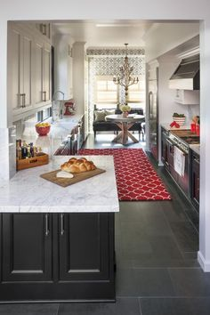 The only way I'd ever have a galley kitchen is of it were at least this wide. Transitional Galley Kitchen With White Marble Countertops Galley Kitchen Design, Small Galley Kitchens, Galley Kitchen Remodel, Grey Kitchens, Home Kitchens, Galley Kitchen Layouts, Galley Kitchen Island, Fitted Kitchens, Kitchen Ikea