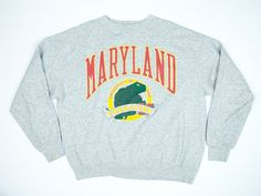 Super comfortable XL! Vintage University of Maryland Terrapins crewneck sweatshirt. In distressed condition, print is very faded but you can still see the lovely turtle looking back at you from over its shell. A couple small holes, one where the tag was (3rd photo), a couple on the cuffs (4th photo), and one in the center below the turtle (2nd photo). Also some paint (4th photo).  << DETAILS >> Mens XL - no tag but fits like a mens XL Distressed condition  << MEASUREMENTS >> Width underarm…