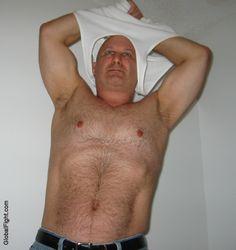 burly bears removing shirt