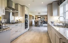 What a wonderful open plan family room - fully integrated kitchen and dining area.