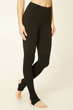 A pair of yoga leggings crafted from stretch-knit with ribbed panels from the knee down and a key pocket.
