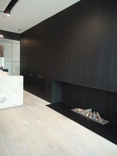 Fireplace with black joinery