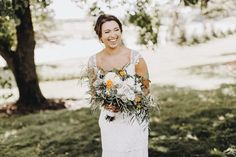 Bridal bouquet with pops of color + natural smile and laughs.  Matt Lien Photography // Acowsay Cinema