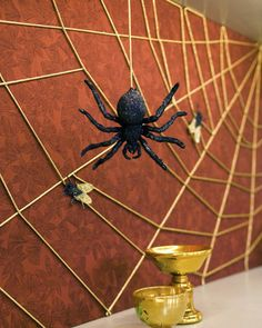 <53 of 75 >  String Spiderweb  Use simple string to create a stunningly spooky web. For the nonsqueamish only: Add a faux tarantula and flies to complete the scene.  How to Make a String Spiderweb