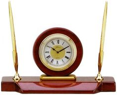 """Rosewood Desk Clock & Pen Set in a High Gloss """"piano finish"""" with Brass Accents. Gift boxed - engravable - Measures: 9""""W x 5""""H x 3-3/4""""D - Available at http://www.theisenclock.com/corporate_gifts_clocks.html"""