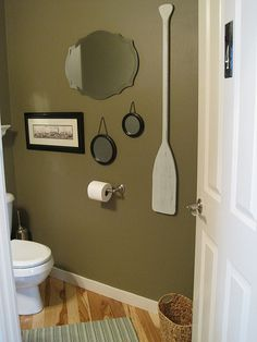 Bathroom paint color: tobacco leaf - Martha Stewart. Like that oar! I think the room is a bit dismal, though. For some good ideas on what colors to use for some brighter accents, see http://www.bathroom-paint.net/bathroom-paint-color.php