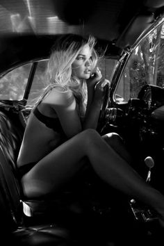 Is it the black n white photo?is it cause she is sexy?or cause she is wearing her undies in a car?!