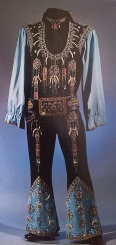 "The 'Chicken Bone' jumpsuit from 1975. Although an original belt was made for this suit, Elvis didn't wear it when he first started using this suit. Instead, he wore the belt that was originally designed for one of the 1975 Dark Blue Two Piece suits (""Light Blue Armadillo, large scale)."