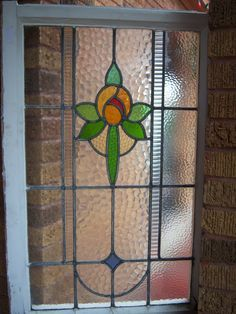 """Tall antique stained glass window. Size 24"""" x 36"""" with 6 vibrant colors. Available for purchase."""