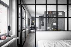 I have been talking about small space living often here, and I love examples like this one, where a small one-room apartment is transformed into a living space with a kitchen, living area and wardrobe. By using a glass partition … Continue reading → Small Space Living, Small Spaces, Living Spaces, Decoracion Vintage Chic, Interior Windows, Gothic Home Decor, White Houses, Minimalist Bedroom, Studio Apartment