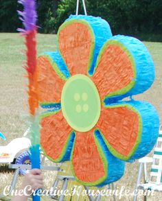 flower pinata from Party City. I placed a button made out of cardstock in the center of it, to make it more Lalaloopsy-ish.