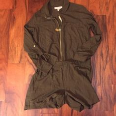 Michael kors  olive green romper. Long sleeve dark olive color romper. Comes with zipper and buttons on sleeves. Michael Kors Shorts