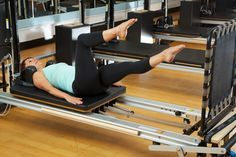 YMCAfit (London LTC) Instructor Trainer Brigitte Wrenn using the Cardio-Tramp™ on the Reformer