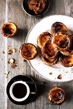 "The famous portuguese ""pasteis de nata""...so , so delicious. Enveryone should taste this at least once...with a pinch of cinnamon...HUUUMM!! and such a beautifull photo, too..."