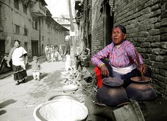 De traditional village of Khokana is still a living museum inside de Kathmandu Valley. De lady is preparing to make beaten rice which is quite famous food in Nepal. Khokana, Bagmati_ Central Nepal