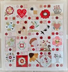 The Splendid Sampler quilt has over 100 blocks; however, I love this layout incorporating the appliqued hexies.
