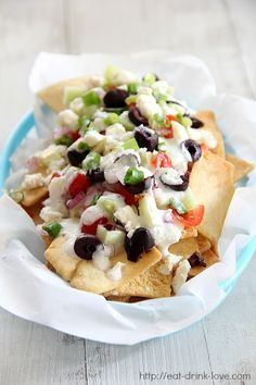 Greek Nachos ~ crunch pita chips topped with fresh cucumber, tomatoes, onion, kalamata olives, feta cheese, and tzatziki sauce!