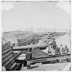 American Civil War artillery: Battery of Parrott Guns Manned by Company C, 1st Connecticut Heavy Artillery - Fort Brady, VA, 1864. The Parrot gun sported an iron barrel that was proved too brittle with the result of the breech often fracturing, with lethal consequences for the gun crew. Note the elaborate preparation of the gun position and the rows of the 10 lb elongated projectile made exclusively for the Parrott.