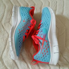New Nike Free Express blue sneakers sz 7.5 New without box Nike Free Express sneakers. Blue and bright coral running sneakers. Super light weight and comfortable. Perfect condition. These are kids 6 which fits a 7.5 women's.  * willing to negotiate price through offer button * * no trades / no paypal * * bundle discounts * Nike Shoes Sneakers