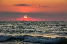 #chicago skyline from indiana sunset across water