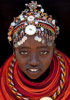 Button and beads for a lovely monster headdress...Rendille girl with pendants on her beaded headdress - Kenya