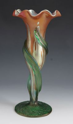 :Loetz   Designer    Description Iridescent glass vase in pink/red Medici decor   Country of Manufacture Austria   Date c.1900