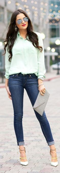 Creamy mint blouse, dark jeans, and a killer pump (love that extra neon strap).