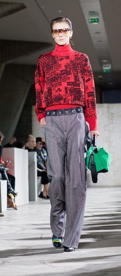 LOEWE Autumn Winter 15 look 2. Herringbone wide leg trousers-wool-silk-blackwhite / Oversize turtle neck jumper-viscose-red-black / Sunglasses-acetate-havana-transparent / Small leaf earring-silver / Ibiza earring-silver-gold / Small leaf earring-silver-black / Puzzle small bag-suede-classic calf-green / Column ring ankle boot-calf-goatskin-navyblue-multicolor / Squared belt-calf-black
