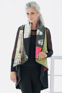 Montage Circle Vest by Andrea Geer. Offering two remarkable looks in one, this reversible vest defines creative innovation: the artist's hand-painted designs are digitally manipulated into this piece's captivating patterning.