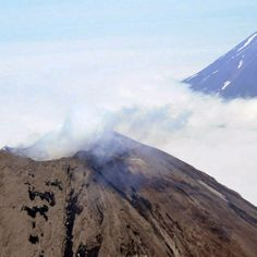 The U.S. Geological Survey reports that a volcano on Alaska's Aleutian Islands erupted Sunday afternoon and sent ash 20,000 feet into the air.