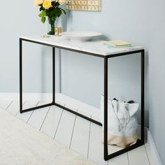Box Frame Console - Marble | West Elm. instead of a radiator cover.