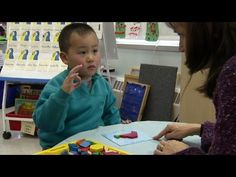 This Pre-K English Language Learner uses gesture to articulate math ideas while putting together a shape puzzle.