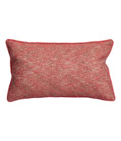Cushion cover woven in bouclé yarn with glittery threads. Piping at edges and back section in cotton twill. Concealed zip.  Size 12 x 20 in. Coral $9.99