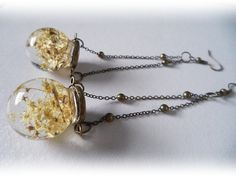 Glass orb earrings with small flowers in resin by zusnA on Etsy