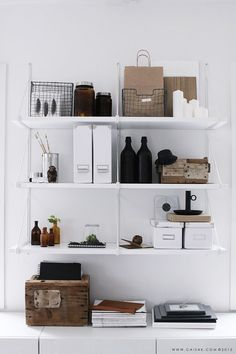 White boxes, brown glass and wooden storage
