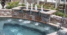 How exceptional is this brick fountain feeding into a pool. Once sealed, our thin brick tile is water resistant and can be used on any structure both indoors and outdoors. Visit our website for more information. Landscaping Retaining Walls, Backyard Pool Landscaping, Backyard Pool Designs, Swimming Pools Backyard, Swimming Pool Designs, Landscaping Ideas, Indoor Waterfall Fountain, Pool Waterfall, Pool Water Features